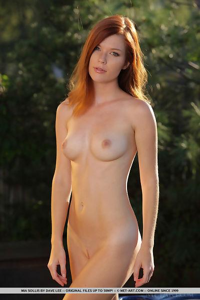 Sweaty redhead Mia Sollis..