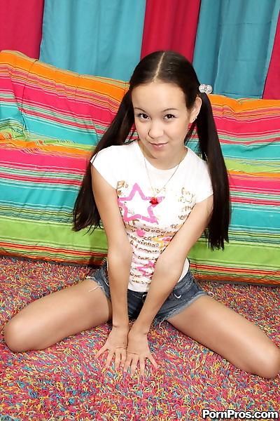 Tiny teen with ponytails..